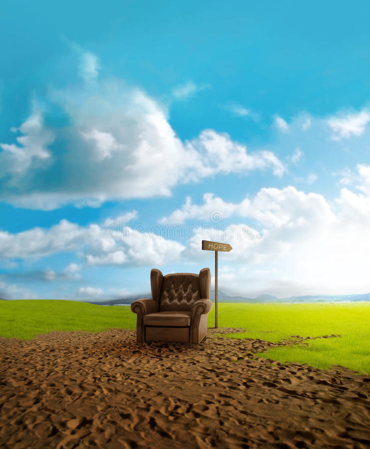 Desertification. Old leather seat abandoned in a grassy field victim of desertification stock image