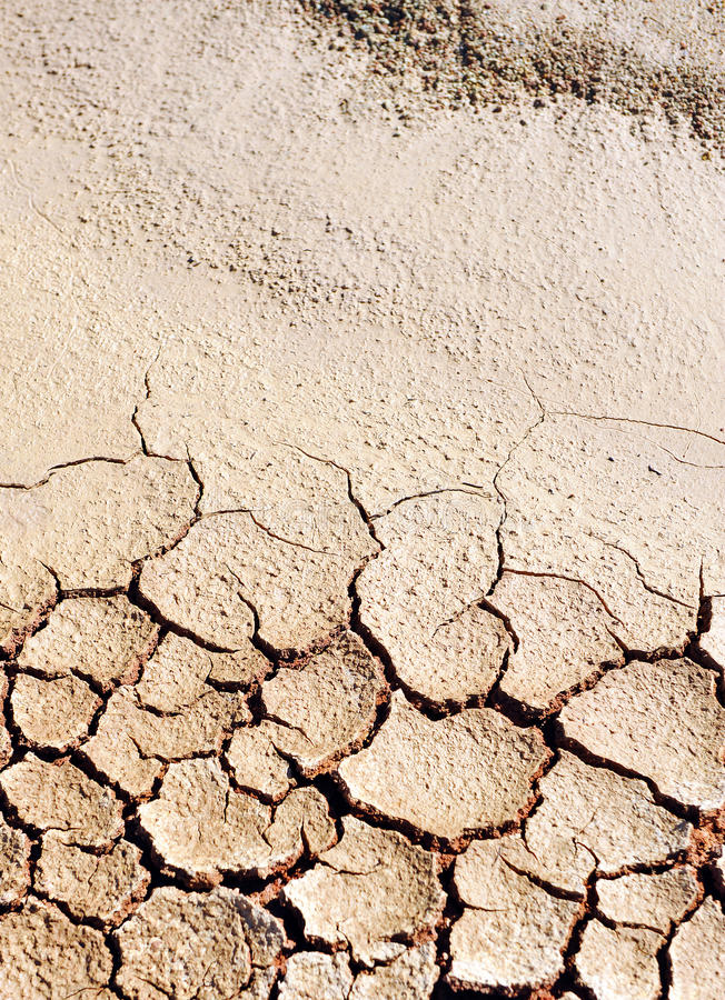 Desertification, climate change, dry and cracked earth. Climate change due to the industrial development of the human being is bringing large areas of fertile royalty free stock photography