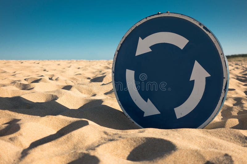Desertification, trafiic sign. Desertification: traffic sign covered by sand royalty free stock image