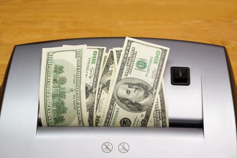 Desfibradora, dólares, uno fotos de archivo