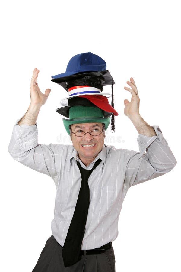 Desgastar demasiados sombreros fotografía de archivo