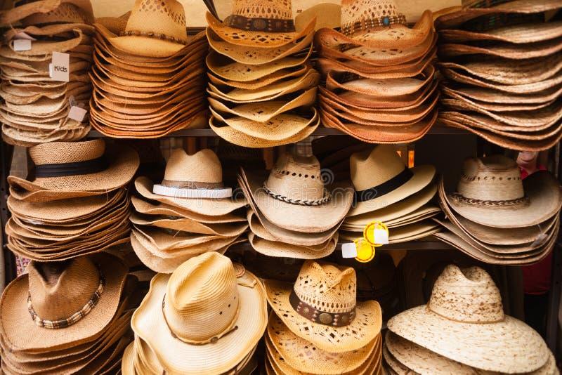 Desgaste ocidental Straw Hats Vendor Festival Cart foto de stock