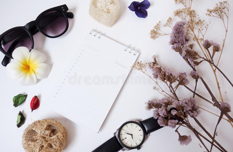 Design background template With notebooks, glasses, paper, clocks and dried flowers royalty free stock images