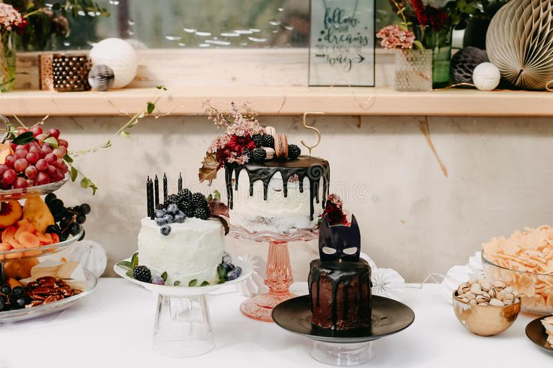 Design birthday party outdoor with baloons and drip chocolate cake stock image