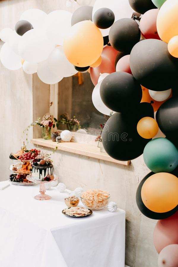 Design birthday party outdoor with baloons and drip chocolate cake. Design birthday party outdoor with baloons royalty free stock photos