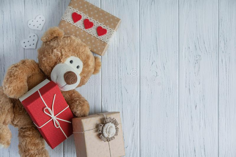 Design of the congratulatory banner with boxes and a toy bear on a white background. Frame for birthday greeting card. Sale and. Design of the congratulatory stock photo