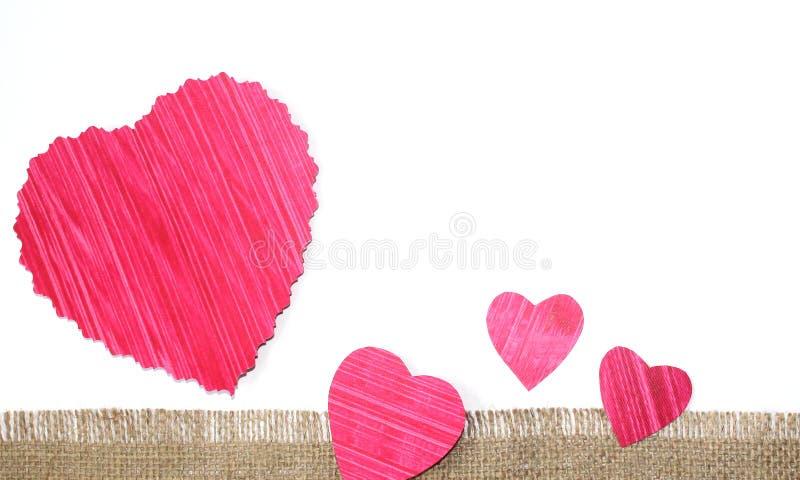 Design cut paper heart shape. Cut paper heart shape with jute cloth banner design photo stock image