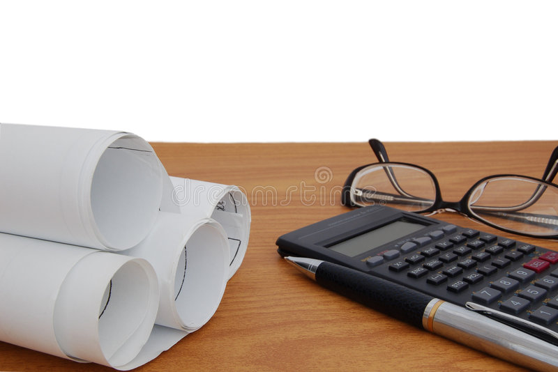 Design draft papers. Pencil glasses and calculator royalty free stock photo