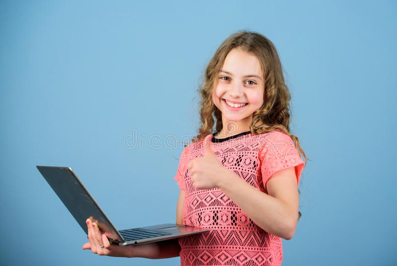 Design expert. kid development digital age. Play internet surfing. happy little girl with notebook. shopping online stock photos