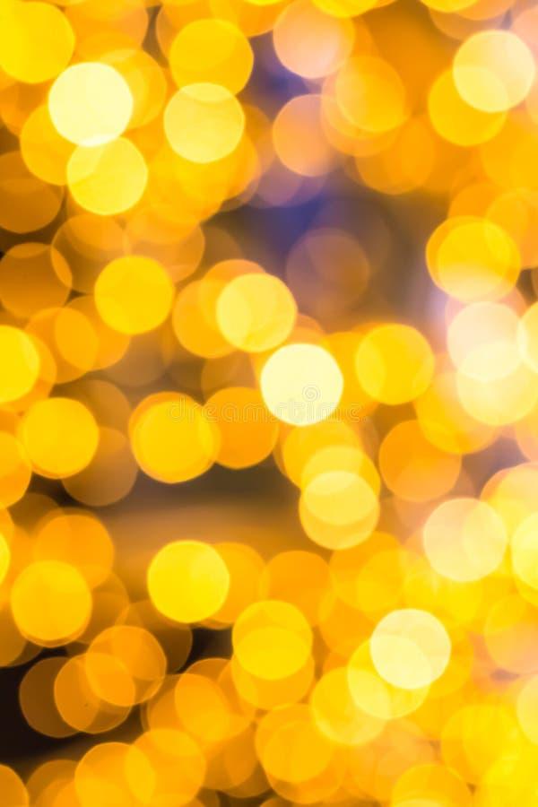 Design för kort för hälsning för nytt år för fundament för abstrakta lyktor för bakgrund guld- gula suddiga färgrik festlig arkivfoto