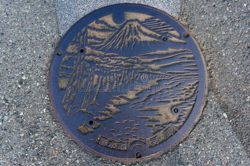 Design för manhålräkning i Shizuoka, Japan arkivfoton