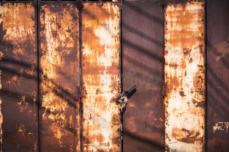 Design of fence steel background . Metal iron copper long old. Sheet of metal peeling paint stock photography