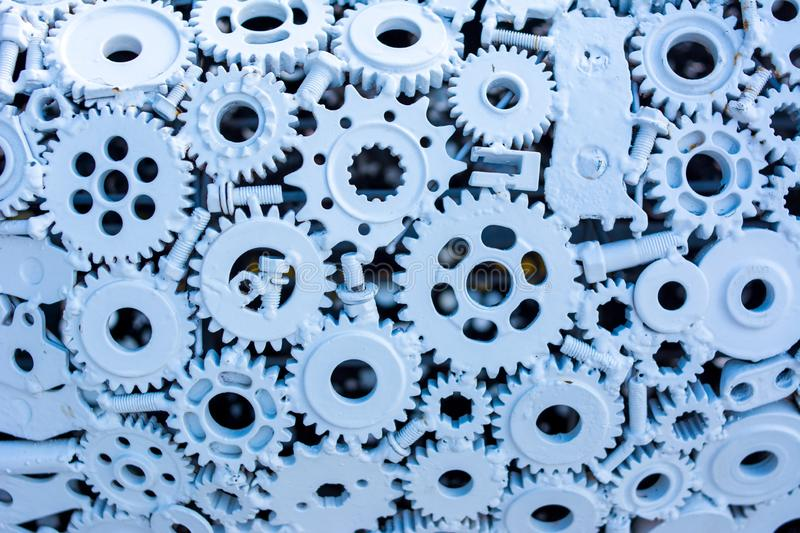 Design of Gear wheel metal pattern and background. Renew of many old rusty metal gears or machine parts. Created metallic gears design in blue background and stock photo