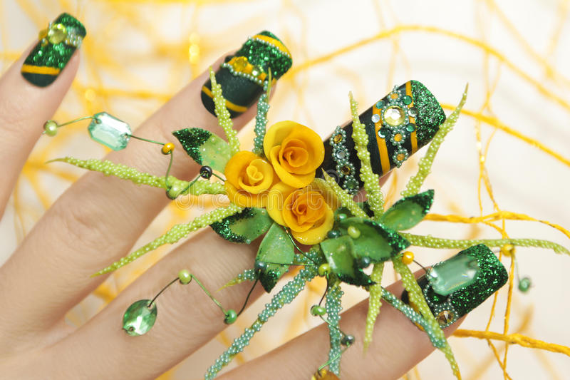 Download Design Green Acrylic Nails With Yellow Roses Stock Image