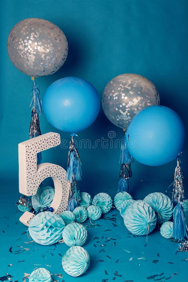 Design for photo shoot locations for birthday five years. In the blue style balls and figure 5 royalty free stock images