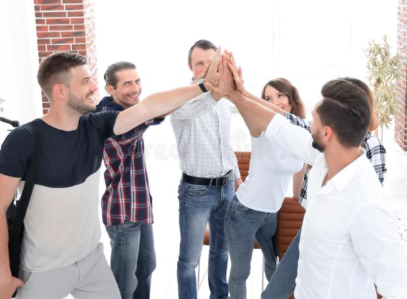 Design team giving each other a high five stock image