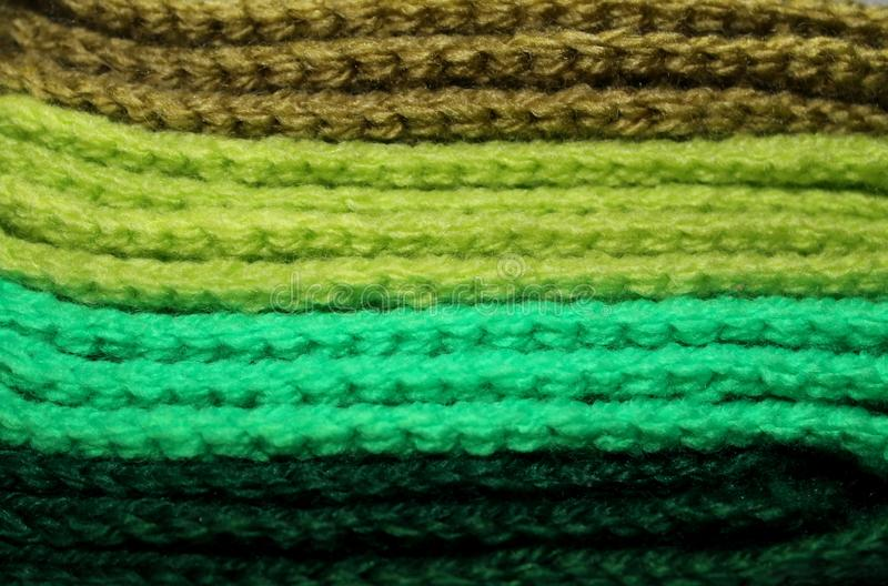 Design texture background of a pale of bright knitted elements stock photos