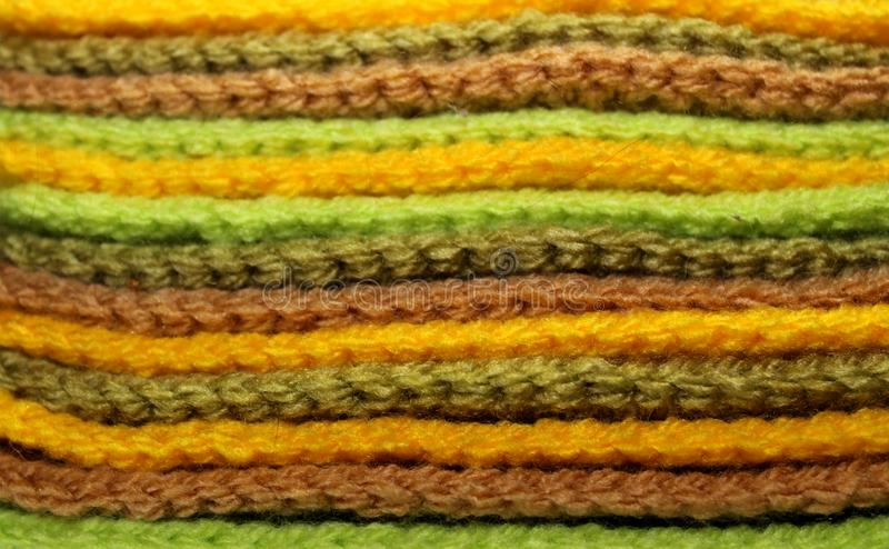 Design texture background of a pale of bright knitted elements royalty free stock photos