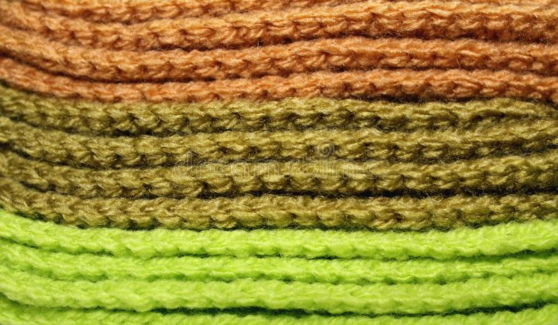 Design texture background of a pale of bright knitted elements stock photo