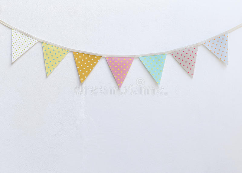 Design vintage fabric party flag over white cement wall texture background royalty free stock photo