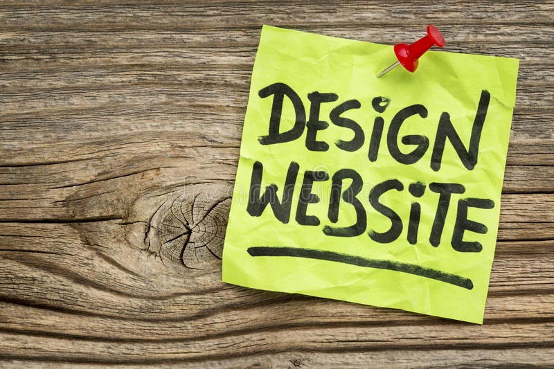 Design website note. Design website reminder - handwriting on a green sticky note against grained and knotted wood board