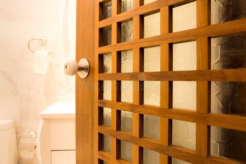 Design of wooden bathdoor with color pearl doorknob stock photography