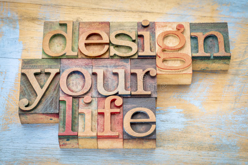 Design your life in letterpress wood type. Design your life - self development concept - word abstract in letterpress wood type printing blocks stock images