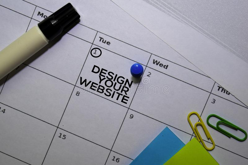 Design Your Website text on white calendar background. Reminder or schedule concept stock images