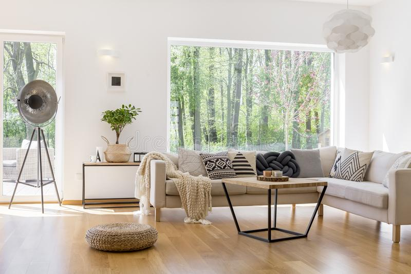 Designed lamp in spacious room stock photos