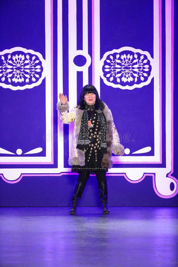 Designer Anna Sui greets the audience after the Anna Sui Fall 2016 show royalty free stock image