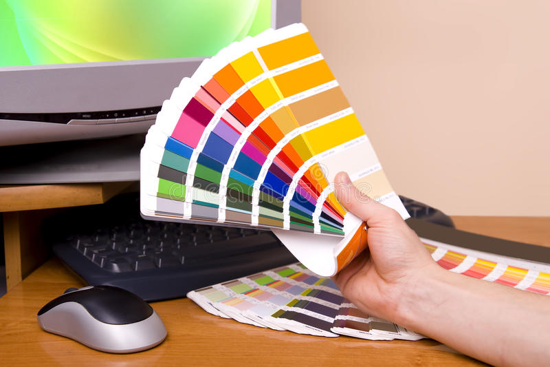 Designer Artist. Designer at work. Color samples on table