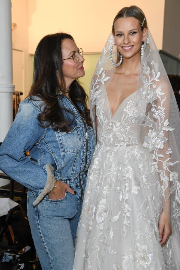 Designer Berta Balilti and model posing backstage before the Berta Bridal Spring 2020 fashion show. NEW YORK, NY - APRIL 12: Designer Berta Balilti and model stock image