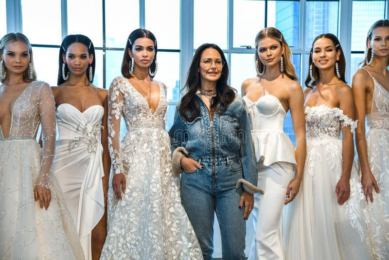 Designer Berta Balilti and models posing backstage before the Berta Bridal Spring 2020 fashion show. NEW YORK, NY - APRIL 12: Designer Berta Balilti and models stock photo