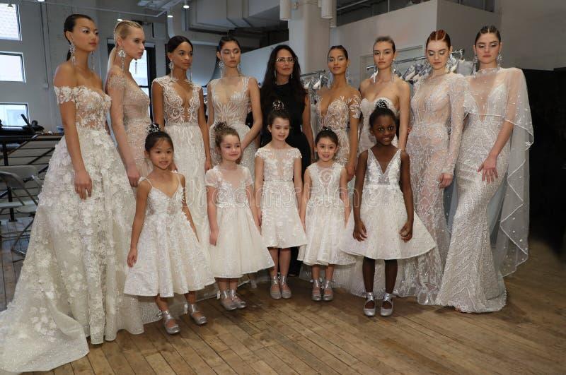 Designer Berta Balilti and models posing backstage before the Berta Bridal Spring 2019 Fashion show. NEW YORK, NY - APRIL 13: Designer Berta Balilti and models stock photo