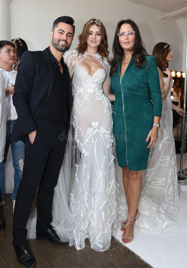Designer Berta Balilti R and guests posing backstage before Berta Bridal 2018 Collection runway show. New York, NY, USA - October 6, 2017: Designer Berta Balilti stock image