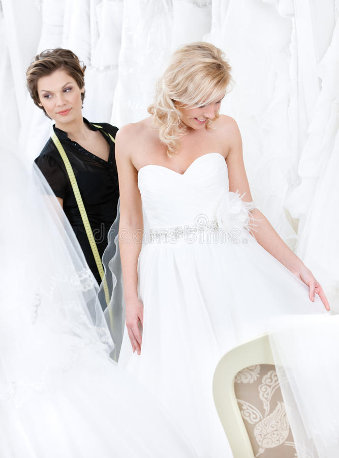 Designer and the bride examine the dress royalty free stock images