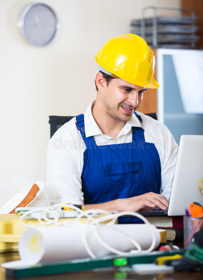 Designer-constructor at work place stock images