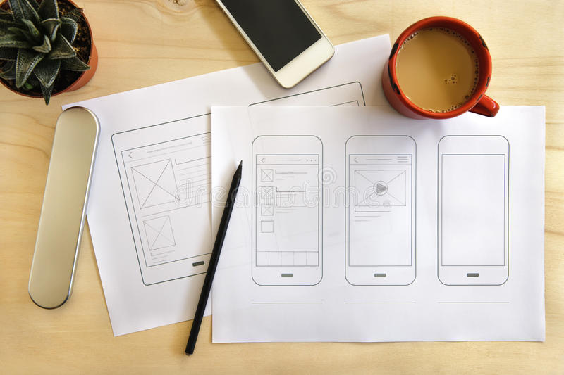 Designer desk with mobile application wireframe. Flat lay royalty free stock photography
