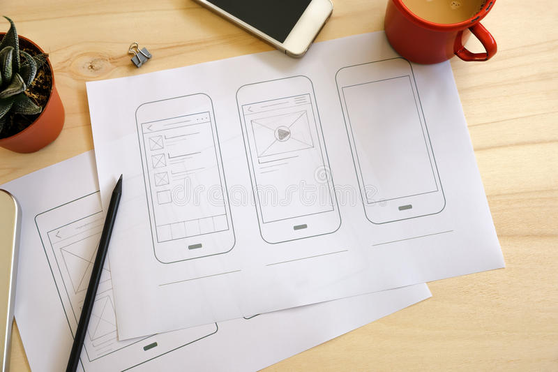 Designer desk with UI wireframe sketches royalty free stock photography