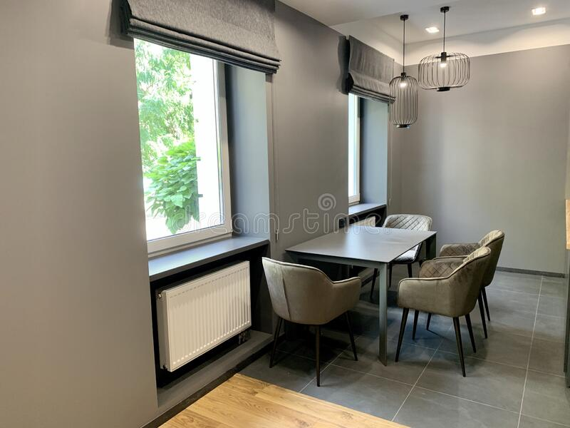 Designer dining room at home stock image