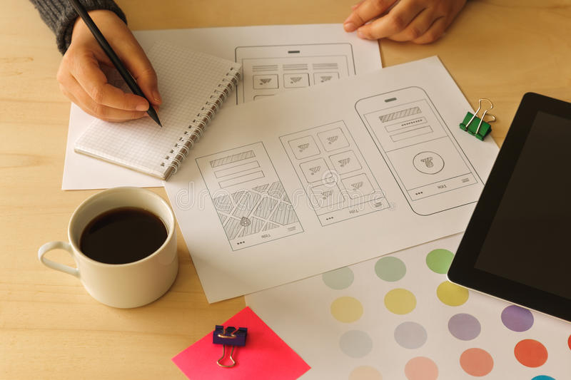 Designer drawing mobile App wireframes stock photography