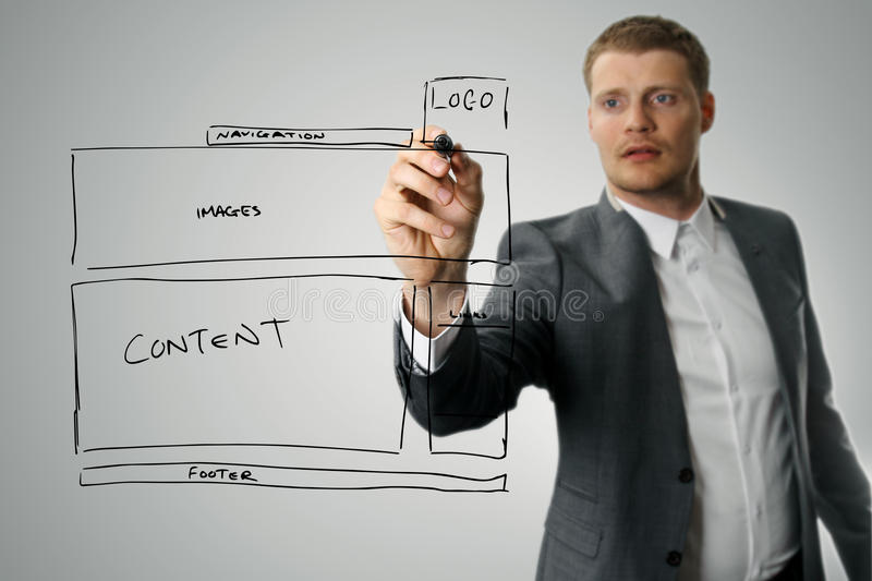 Designer drawing website development wireframe royalty free stock photos