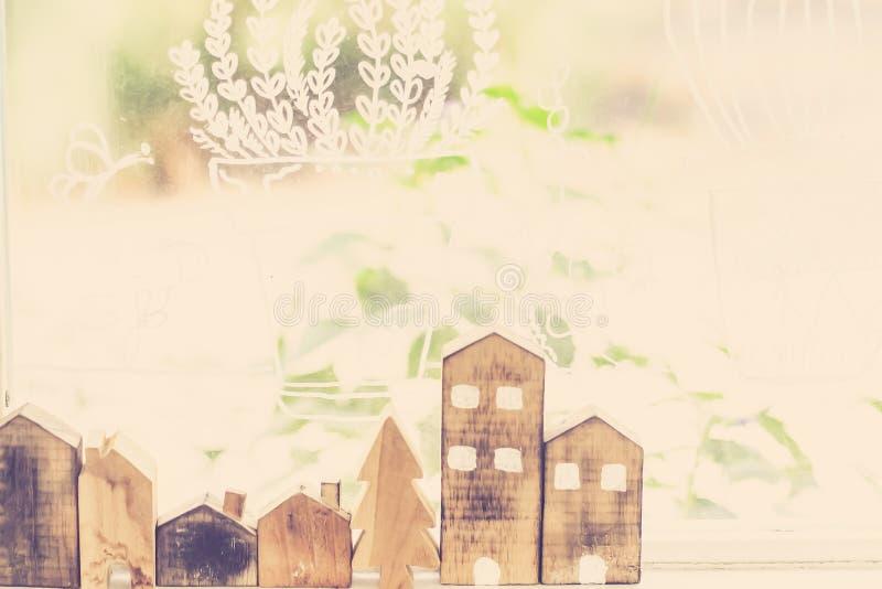Designer hand present wooden shape house model home insurance ideas concept.  stock photos