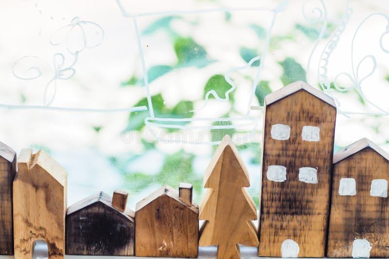 Designer hand present wooden shape house model home insurance ideas concept.  stock images