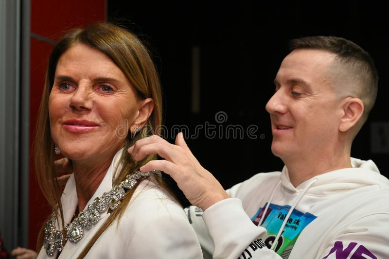 Designer Jeremy Scott and Anna Dello Russo posing backstage before the Moschino show. MILAN, ITALY - FEBRUARY 21: Designer Jeremy Scott and Anna Dello Russo royalty free stock image