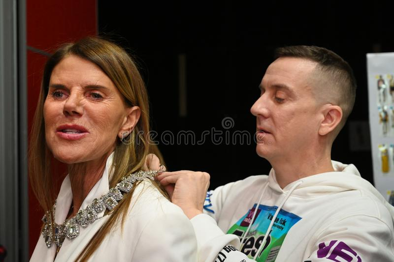 Designer Jeremy Scott and Anna Dello Russo posing backstage before the Moschino show. MILAN, ITALY - FEBRUARY 21: Designer Jeremy Scott and Anna Dello Russo stock photos