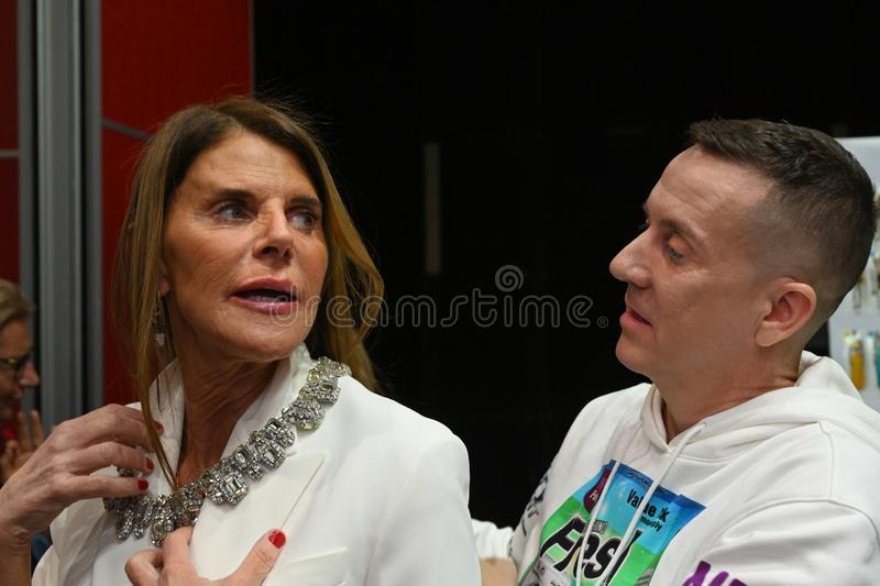 Designer Jeremy Scott and Anna Dello Russo posing backstage before the Moschino show. MILAN, ITALY - FEBRUARY 21: Designer Jeremy Scott and Anna Dello Russo royalty free stock photo