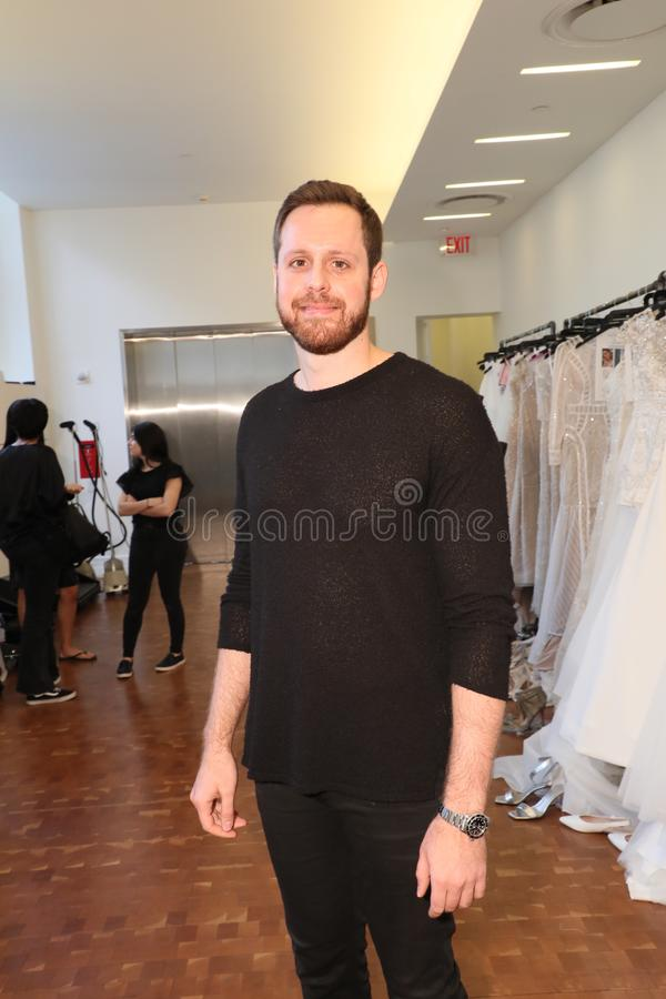 Designer Justin Alexander posing backstage before the Justin Alexander Spring 2019 Bridal Fashion show. NEW YORK, NY - APRIL 13: Designer Justin Alexander posing stock images