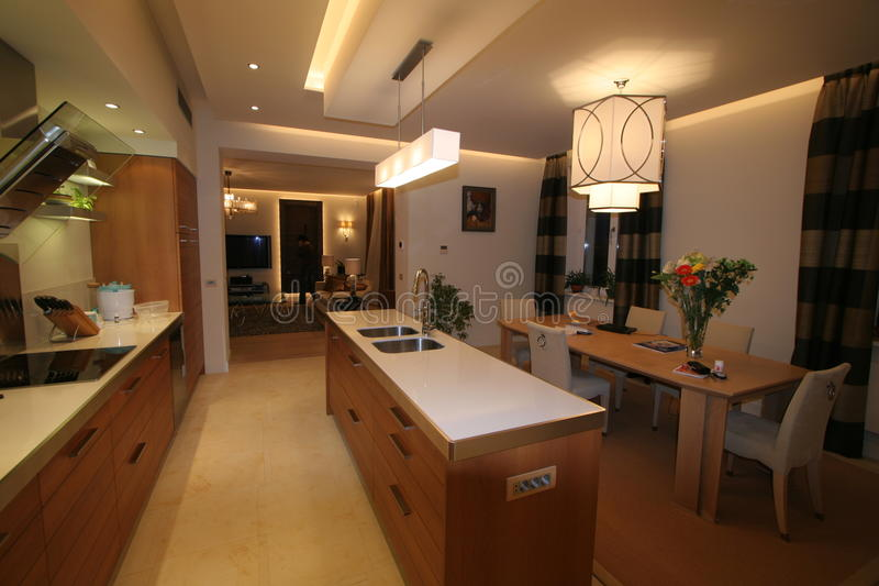 designer kitchen overlooking dining room stock photo