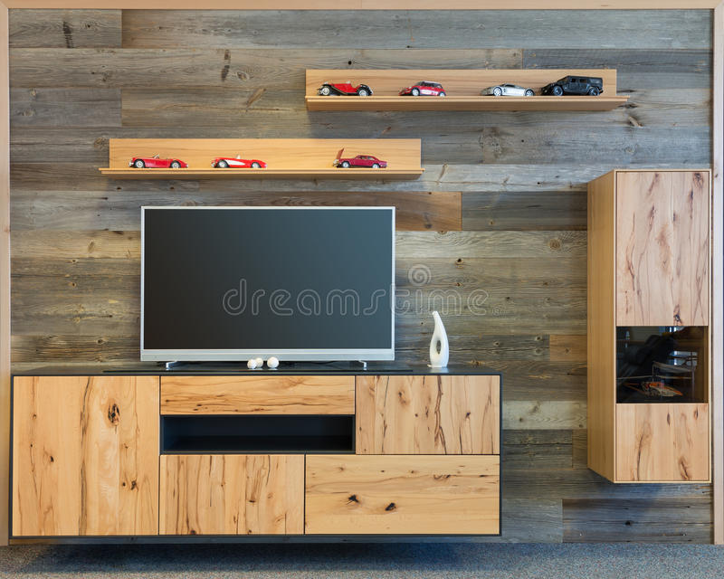 Designer living room wall with tv wooden cupboard. And shelf stock photo